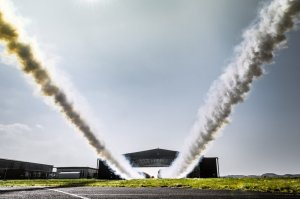 Paul Bonhomme and Steve Jones leave contrails after flying through a hangar during Red Bull Barnstorming photoshooting in Llandbedr, Wales, UK, on April the 09th, 2015